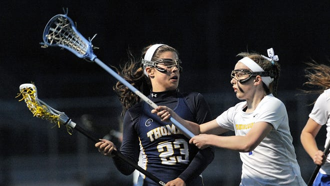 Webster Thomas' Nicole Voci, left, is defended against by Irondequoit's Meghan Vadala.