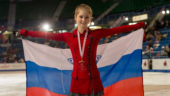 Julia Lipnitskaia, of Russia, celebrates after winning the women's competition at the Skate Canada figure skating event in Saint John, New Brunswick on Saturday.