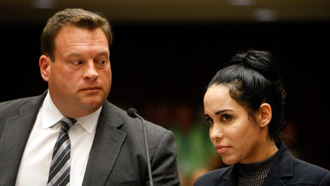 Nadya Suleman, right, appeares in a Los Angeles Superior courtroom with her attorney Arthur J. La Cilento Friday, Jan. 17, 2014.