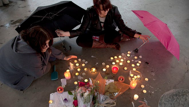 People gather at a memorial honoring teen Amanda Todd in Maple Ridge, B.C., Canada, on Oct. 15, 2012. The 15-year-old committed suicide after detailing her harassment on a YouTube video watched by millions around the world.