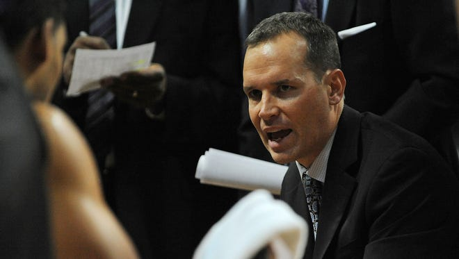 Northwestern men's basketball coach Chris Collins addresses his team during a timeout of a game against UCLA on Nov. 29 in Las Vegas. Collins has returned to his hometown of Chicago for his first head coaching job.