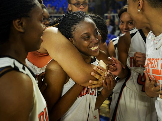 Middleton High School and TSSAA Miss Basketball Runner-up Averyale Joy sheds tears and is hugged by teammates after Middleton defeated Clarkrange, 62-50, to become the 2015 TSSAA Girls' Class A Champions, Sunday.