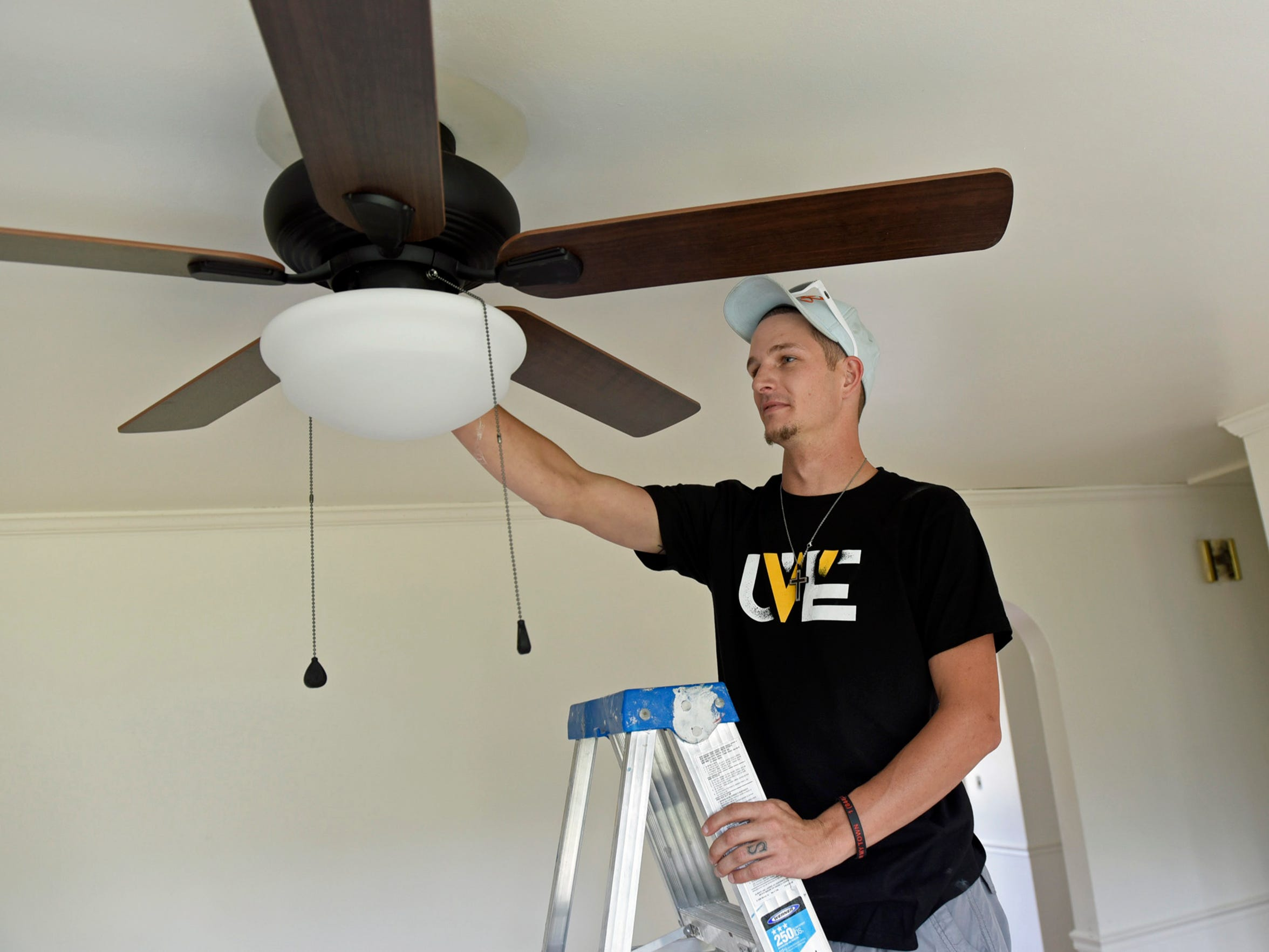 Drew Reed, director of Noah's House, makes adjustments on  Wednesday, July 20, 2016 to a ceiling fan he had installed on at his addiction recovery house east of Chambersburg.