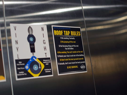Roof Tap rules are posted in the elevator at Titletown Brewing Company's Tap Room in downtown Green Bay on Wednesday, July 13, 2016.