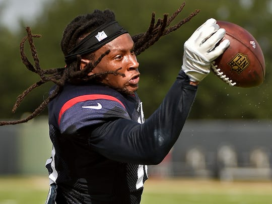 Houston Texans wide receiver DeAndre Hopkins catches a pass during a practice at the NFL football team's training camp, Saturday, Aug. 6, 2016, in Houston.
