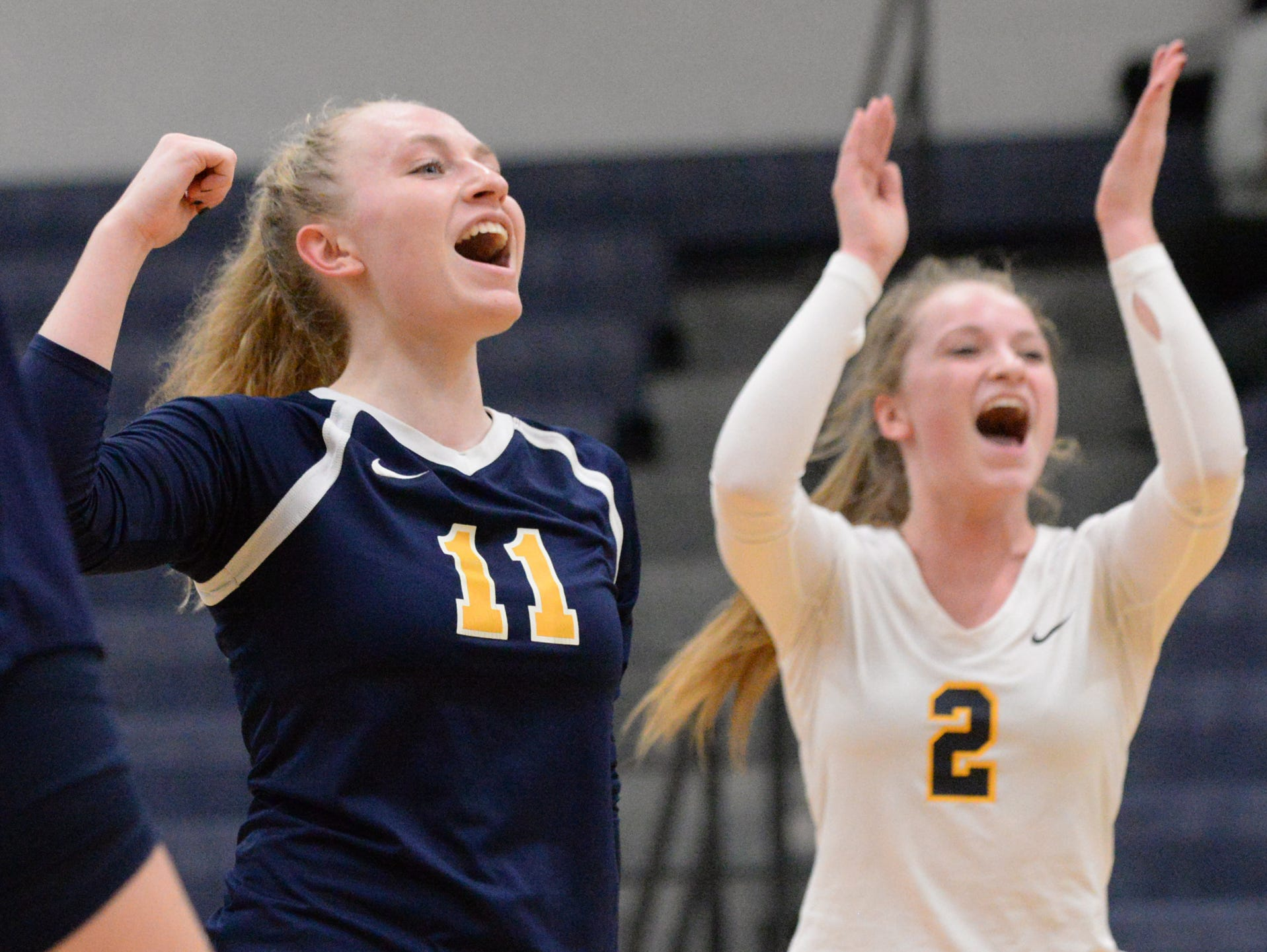 Haslett's Lane Valley and Jordan Valley celebrate after defeating Williamston in three sets on Thursday.