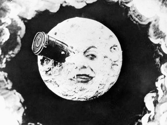 """This still image from the 1902 silent film """"Le Voyage Dans La Lune"""", written and directed by Georges Méliès shows """"the man in the moon"""" with a bullet-shaped space capsule lodged in his eye.(AP Photo)"""