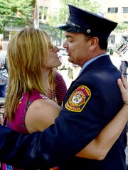 Firefighter of the Year Tony Caruso and his wife Marci embrace after the York City Fire Department's awards ceremony at York City Hall Thursday, August 16, 2018. Bill Kalina photo
