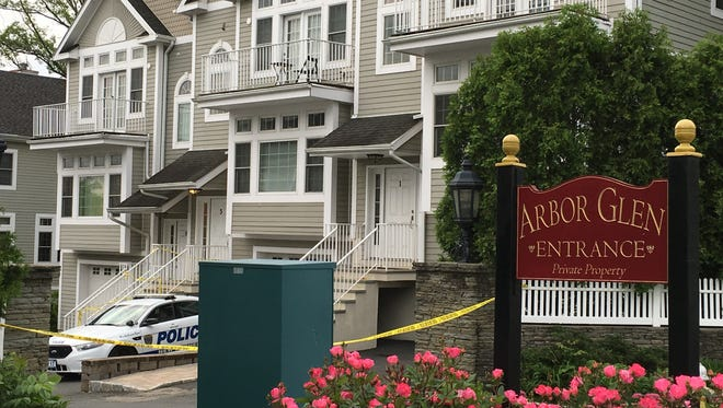 New Rochelle police tape off 3 Arbor Glen, where 7-year-old Gabrielle White was found dead on Tuesday, June 6, 2017. Her father, Neil White, 47, was charged with murder.
