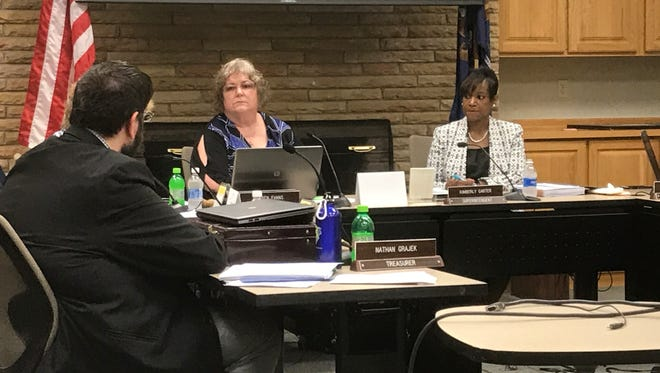 Battle Creek Board of Education Treasurer Nathan Grajek makes a point during Monday's meeting. Pictured, to his left, board Vice President Karen Evans and Superintendent Kim Carter.