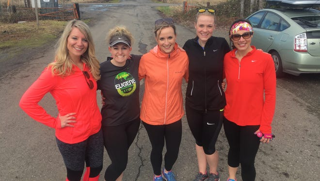 Licking Valley graduate Ashley Johnston Strausser, far right, is one of five women participating in a 30 for 30 on Hwy 30 run to raise money for Charity: Water in Oregon on April 15.