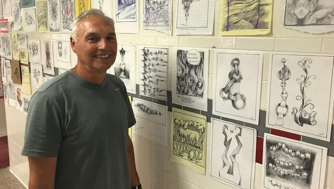Bob Zanot, shown with some of the 1,800-plus of his sketches displayed in the corridor outside his Chenango Valley High classroom, is about to retire following 42 years teaching and 110 seasons coaching sports.