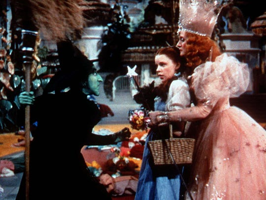 "The Wicked Witch of the West, left, played by Margaret Hamilton, confronts Dorothy, played by Judy Garland, and Glinda, the Witch of the North, played by Billie Burke, right, in this scene from ""The Wizard of Oz."""