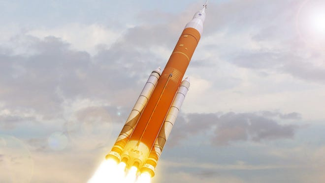 This undated image made available by NASA shows an artist's rendering of the Space Launch System. Still in development, the super-sized rocket is meant to eventually send astronauts to Mars.