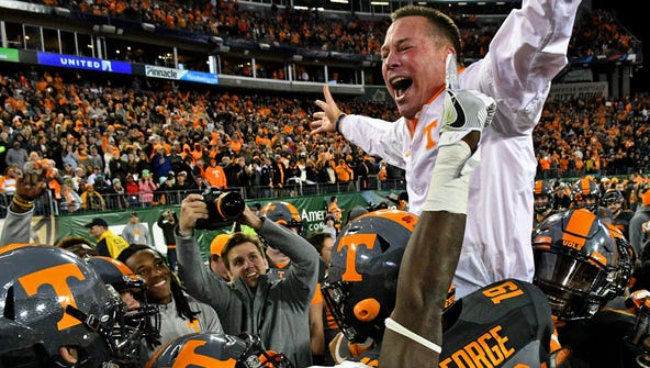 Tennessee Volunteers head coach Butch Jones celebrates