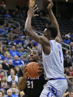 Feb 10, 2016; Newark, NJ, USA; Butler Bulldogs forward Roosevelt Jones (21) drives to the basket in front of Seton Hall Pirates forward Michael Nzei (1) during the first half at Prudential Center. Mandatory Credit: Vincent Carchietta-USA TODAY Sports
