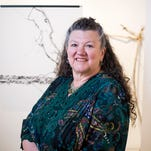 """Artist Kathryn Niles with works from her exhibit """"Another World"""" at Cooperative Gallery 213 in Binghamton."""