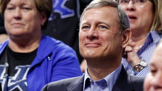 Chief Justice of the U.S. Supreme Court John Roberts watches the first half of Tuesday's game between Kentucky and Georgia at Rupp Arena in Lexington.