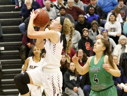 Alexus Boorse of Elmira goes in for a layup in front