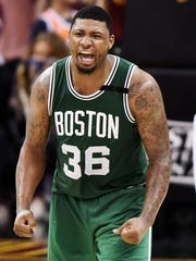 Boston Celtics guard Marcus Smart (36) celebrates after