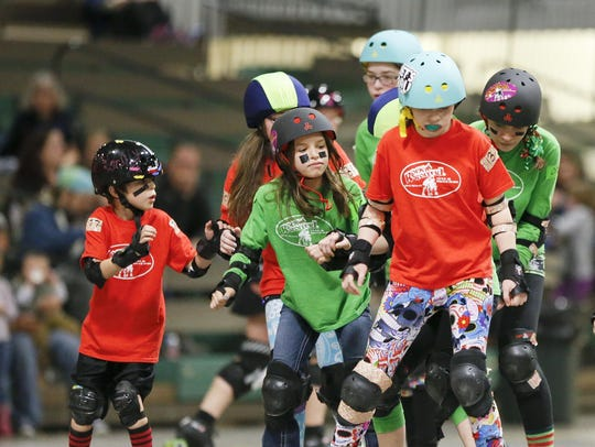 The Rock'N Rollerz, a junior co-ed roller derby team,