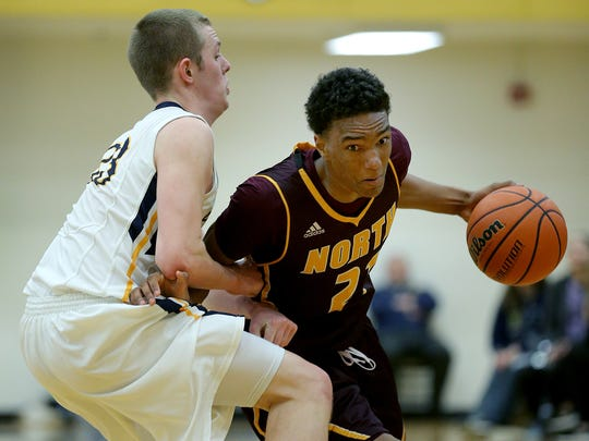 Butler coach Chris Holtmann watched Bloomington North's Musa Jallow (right) during the Bulldogs' off week.