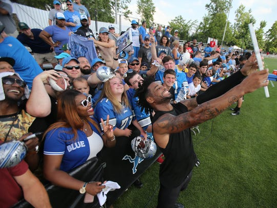 Detroit Lions' Darius Slay takes a selfie with fans after training camp Monday, August 1, 2016 at the practice facility in Allen Park.