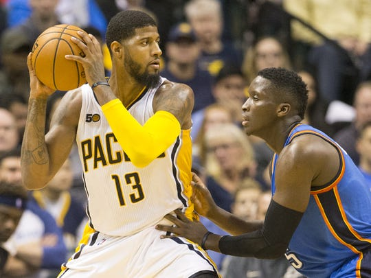 FILE – Paul George is defended by Victor Oladipo, at