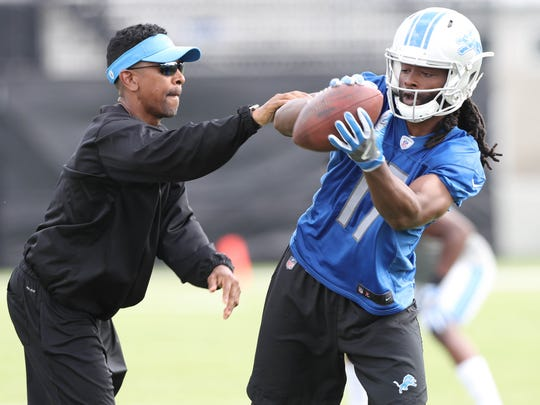 Receiver coach Robert Prince works with Detroit Lions receiver Keshawn Martin after practice Sunday, July 30, 2017 in Allen Park.