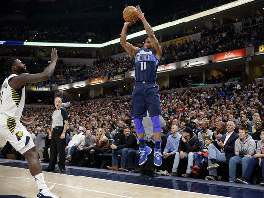 Dallas Mavericks guard Yogi Ferrell (11) shoots a 3-point