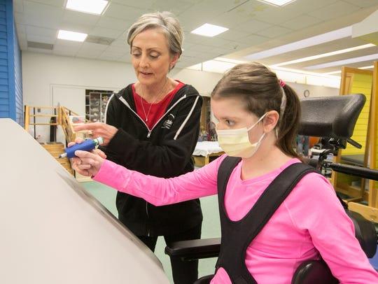 Heart transplant recipient Rebecca Conroy, 12, right,