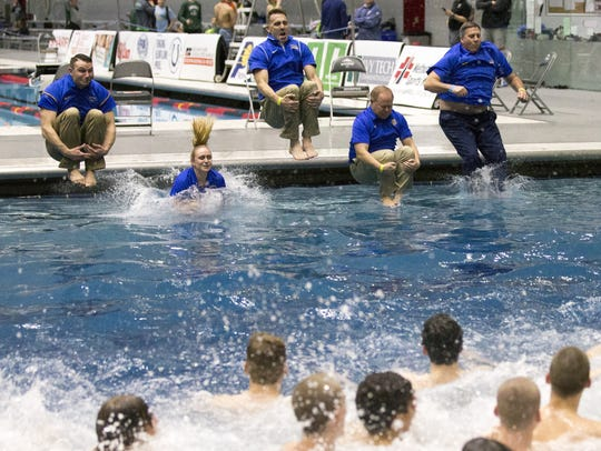 Carmel High School swim coaches jump into the diving