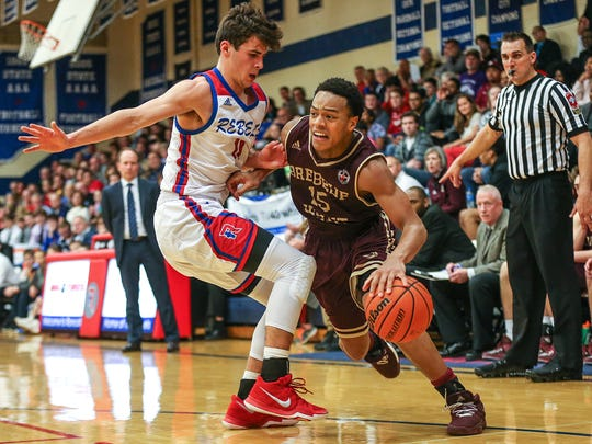 Brebeuf Jesuit's Simon Banks (right) averages 15.5