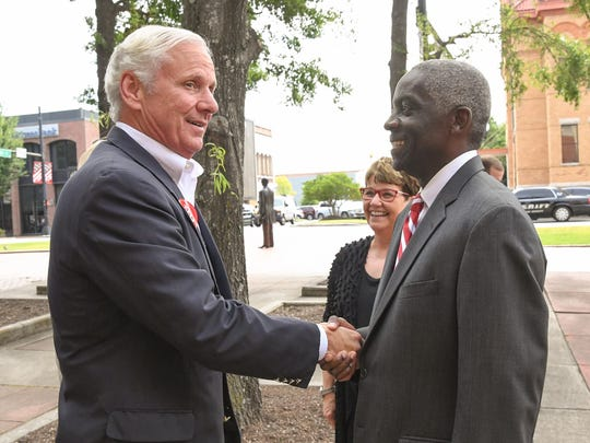 Gov. Henry McMaster shakes hands Thursday with Anderson