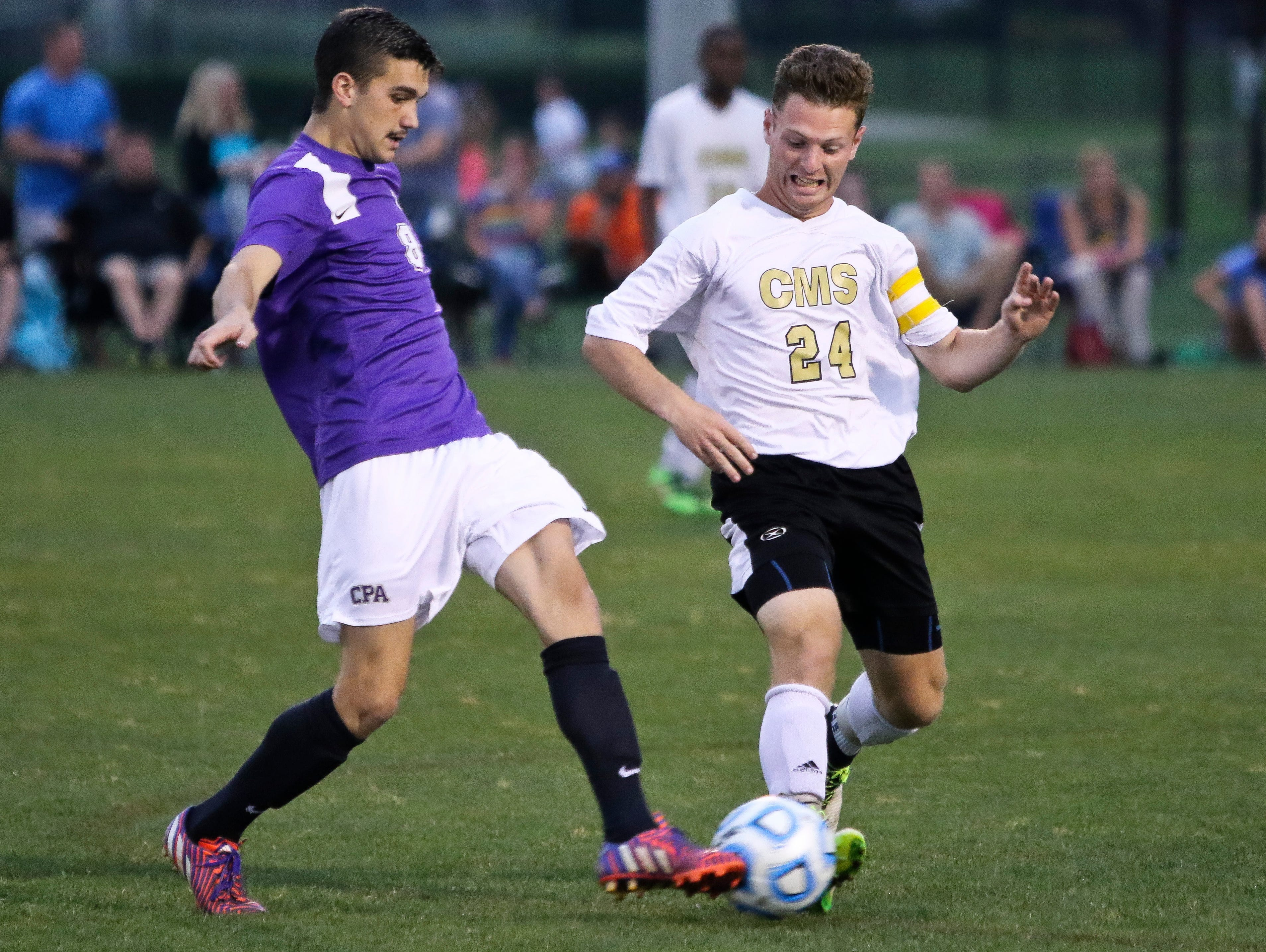 CPA's Harrison Myers and Central Magnet's Kyle Shoemaker battle for the battle early in their Wednesday night match at the Richard Siegel Soccer Complex.