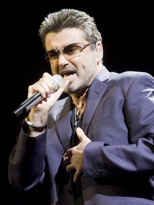 George Michael performs at the then U.S. Airways Center in Phoenix June 23, 2008.