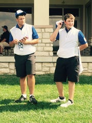 Medalist Marc Wilkins Jr. (right) and Ontario teammate Dominic Castelvetere talk about their rounds after Thursday's Mid-Ohio Athletic Conference golf tournament at Apple Valley.