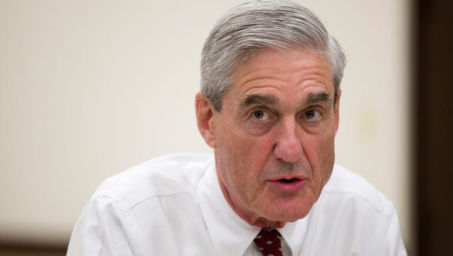 Then-FBI director Robert Mueller speaks Aug. 21, 2013, during an interview at FBI headquarters in Washington. The Justice Department on May 17, 2017, appointed Mueller as a special counsel to oversee a federal investigation into potential coordination between Russia and the Trump campaign during the 2016 presidential election.