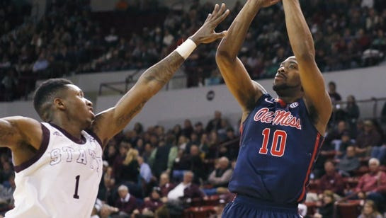 Mississippi guard Ladarius White (10) gets off a shot at the basket past Mississippi State guard Fred Thomas (1) during the second half at an NCAA college basketball game in Starkville, Miss., Thursday, Feb. 19, 2015. Mississippi won 71-65. (AP Photo/Rogelio V. Solis)