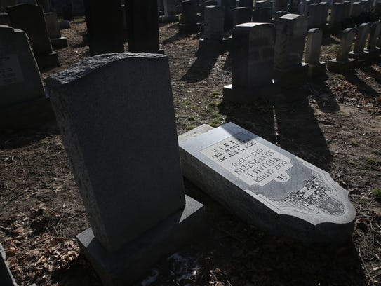 More than a dozen headstones were pushed over at Waad