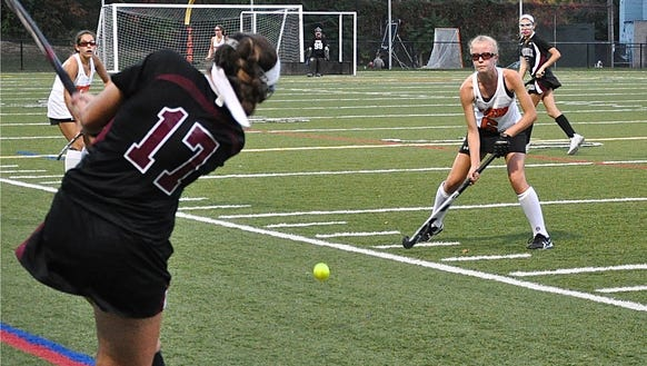 Scarsdale's Angie Burns tries to drive the ball past