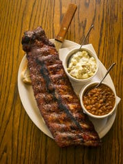 Wobbly Boots Roadhouse full rack of ribs (DRY) with baked beans and potato salad.