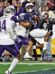 Penn State wide receiver DaeSean Hamilton (5) pulls in a touchdown pass as Washington defensive back Myles Bryant defends during the second half of the Fiesta Bowl NCAA college football game, Saturday, Dec. 30, 2017, in Glendale, Ariz. (AP Photo/Rick Scuteri)