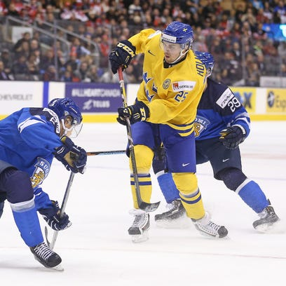 Axel Holmstrom of Sweden shoots against Finland during