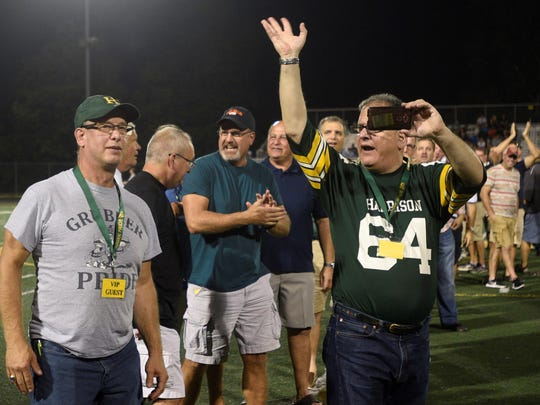 Former Harrison football players Don Gully (left) and