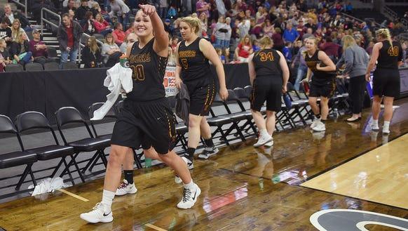 Harrisburg's Jeniah Ugofsky points to her classmates
