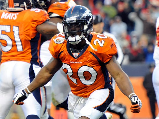 FILE - In this Nov. 14, 2010 file photo, Denver Broncos safety Brian Dawkins celebrates a goal line stand against the Kansas City Chiefs during an NFL football game in Denver. Dawkins was elected to the Pro Football Hall of Fame on Saturday, Feb. 3, 2018. (AP Photo/Jack Dempsey, File)