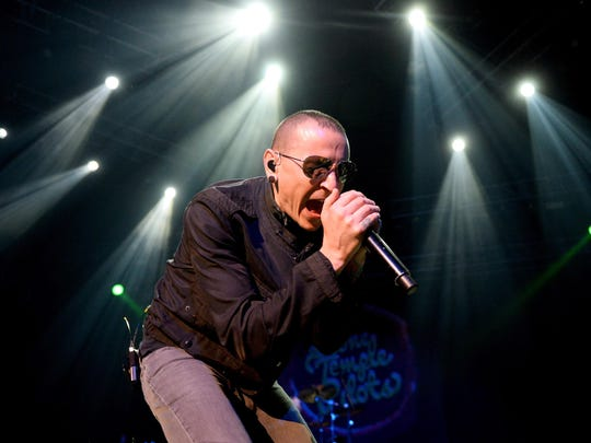 Musician Chester Bennington of Linkin Park has died July 20, 2017 at his home in Palos Verdes Estates, California. His death has been reported as a suicide. He was 41. LAS VEGAS, NV - DECEMBER 15: Singer Chester Bennington of Stone Temple Pilots performs during KOMP'S Totally Politically Correct Holiday Bash at The Joint inside the Hard Rock Hotel & Casino on December 15, 2013 in Las Vegas, Nevada.