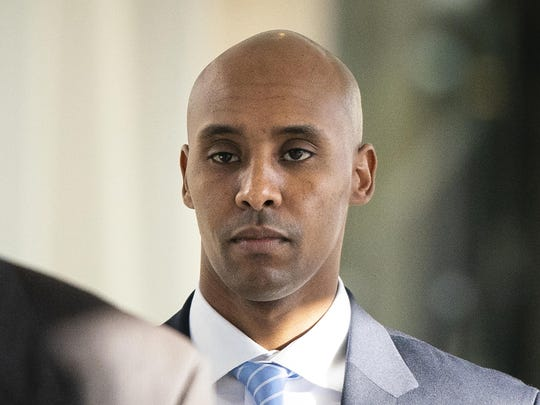 In this Friday, April 26, 2019, file photo, former Minneapolis police officer Mohamed Noor walks to court in Minneapolis.