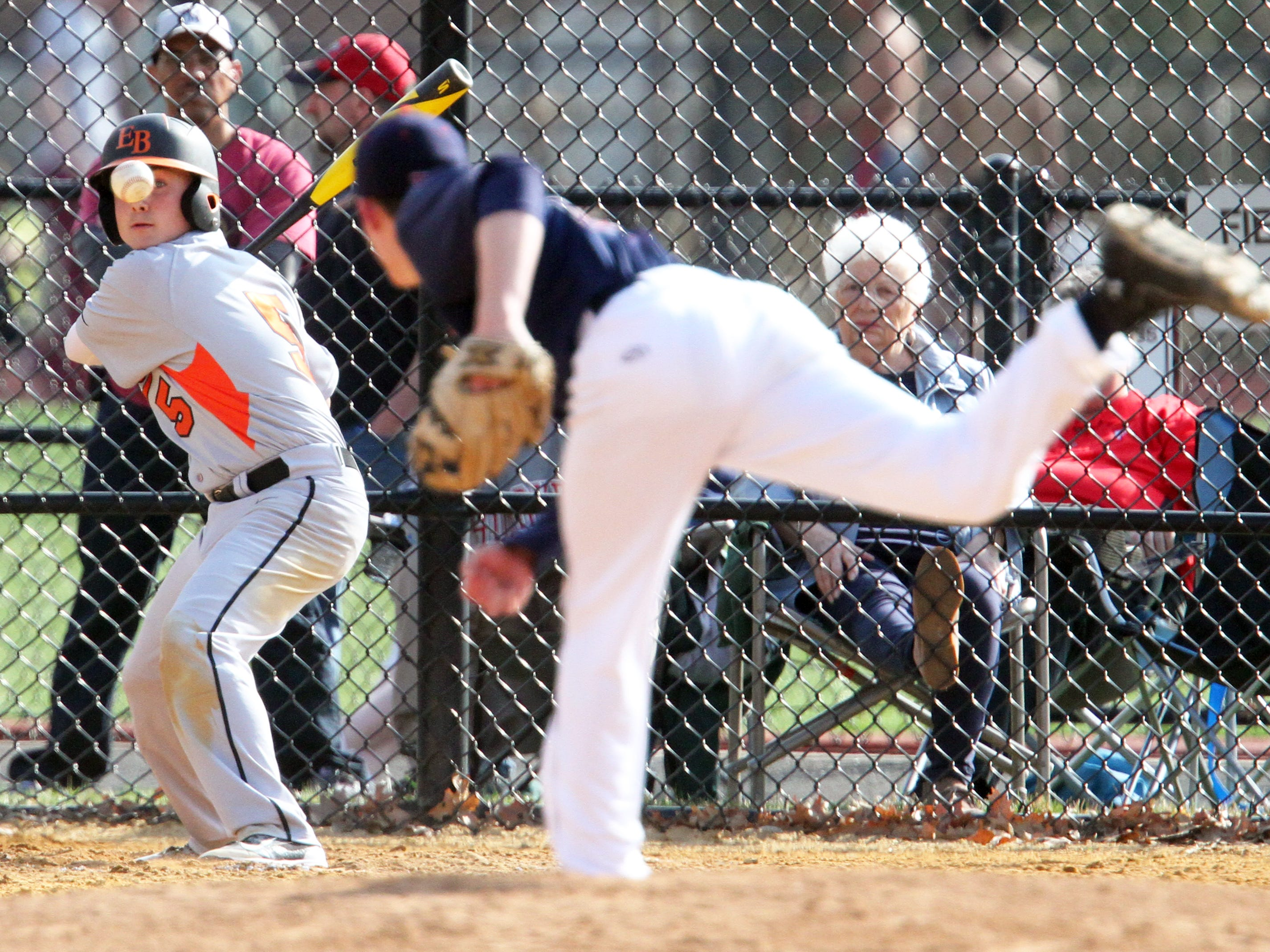Dunellen takes on East Brunswick Tech in a varsity baseball game in Dunellen on Friday April 17,2015. Batter # 5 (left) East Brunswick's # 5 Vincent Pellicane keeps his eye on the ball as Dunelle pitcher # 5 (right) David Johnson tries to haul the ball by him.